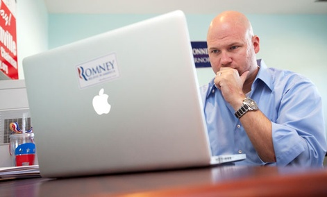 A Romney volunteer works on a campaign Facebook page in 2012.