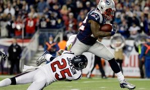 The Texans cornerback Kareem Jackson Houston (25) fails to contain Steven Ridley, running back for the New England Patriots to score a touchdown in the NFL playoffs.