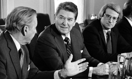 President Ronald Reagan talks with Treasury Secretary Donald Regan, left, while office of Management and Budget Director David Stockman looks on in the Cabinet Room of the White House, Monday, Jan. 28, 1985.