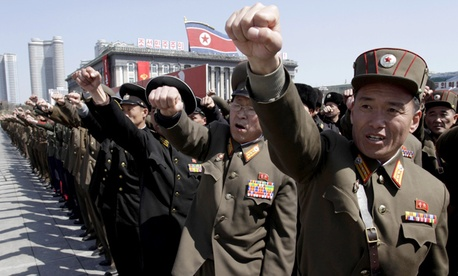 North Korean army officers punch the air as they chant slogans during a rally at Kim Il Sung Square in downtown Pyongyang.