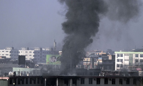 Smoke billows from Kabul traffic police headquarters in January.
