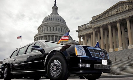 One of President Barack Obama's motorcade vehicles is seen parked in front of the US Capitol Building.