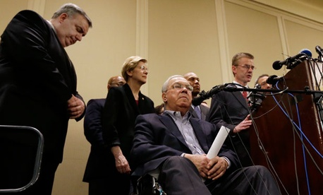 From left, Boston Police Commissioner Ed Davis, Sen. Elizabeth Warren, D-Mass., Boston Mayor Thomas Menino and Massachusetts Governor Deval Patrick listen to FBI Special Agent in Charge Richard DesLauriers speak Tuesday.