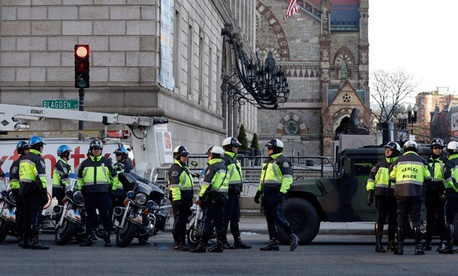 Boston police officers keep a perimeter secure in Boston's Copley Square Tuesday morning.
