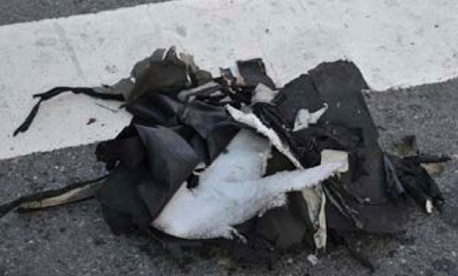The remains of a black backpack sit on a Boston street that the FBI says contained one of the bombs that exploded during the Boston Marathon Tuesday.