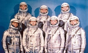 The Project Mercury Astronauts. They are: front row, left to right, Walter H. Schirra, Jr., Donald K. Slayton, John H. Glenn, Jr., and Scott Carpenter; back row, Alan B. Shepard, Jr., Virgil I. Gus Grissom, and L. Gordon Cooper.