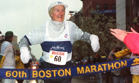 Johnny Kelley crosses the finish line of his 60th Boston Marathon in this April 16, 1991 file photo.Kelley, a former three time Olympian, died Oct. 6, 2004, aged 97.