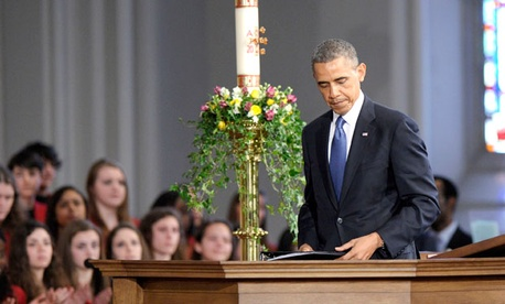 "President Barack Obama finishes speaking at the ""Healing Our City: An Interfaith Service"" at the Cathedral of the Holy Cross in Boston."