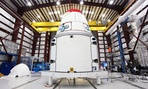 The SpaceX Dragon spacecraft inside a processing hangar at Cape Canaveral Air Force Station in Cape Canaveral, Fla. 