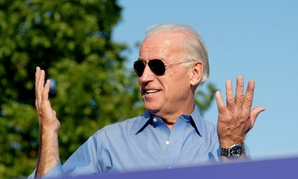 Vice President Joe Biden reacts to a comment by President Obama about his sunglasses.