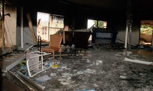 Glass, debris and overturned furniture are strewn inside a room in the gutted U.S. consulate in Benghazi, Libya, after an attack that killed four Americans.
