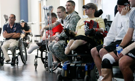 Wounded soldiers involved in physical therapy wait at the Center For The Intrepid at the Brooke Army Medical Center in San Antonio, Texas. Fathers of wounded veterans such as these may soon be eligible for a hiring preference.