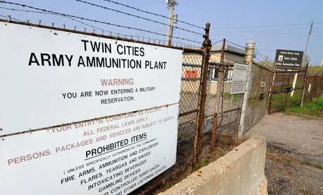 Signs at the entrance of the Twin Cities Army Ammunition Plant.