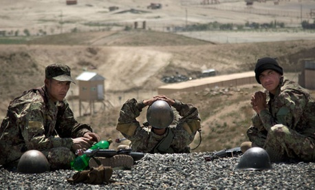 Afghan Army soldiers rest between training sessions at a military training facility on the outskirts of Kabul, Afghanistan.