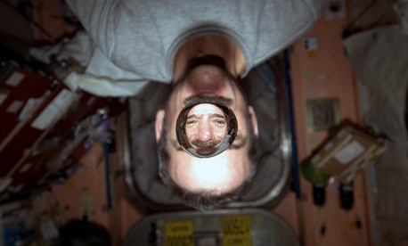 Chris Hadfield experiments with water drops in microgravity