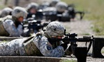 Female soldiers from 1st Brigade Combat Team, 101st Airborne Division train on a firing range in 2012