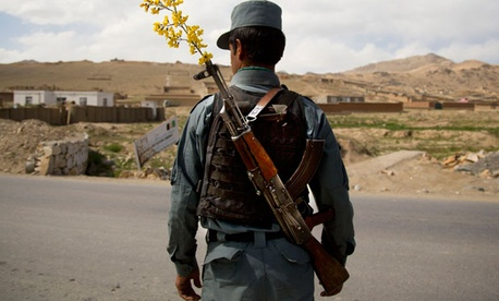 An Afghan National Police officer watches over a checkpoint
