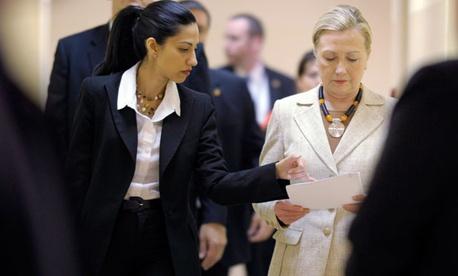 Huma Abedin, left, aide to former Secretary of State Hillary Rodham Clinton, right.