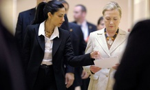 Huma Abedin, left, aide to former Secretary of State Hillary Rodham Clinton, right.