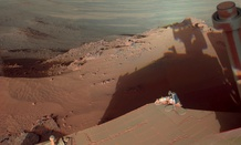 Mars Rover Opportunity catches its own late-afternoon shadow in a view eastward across Endeavour Crater on Mars.