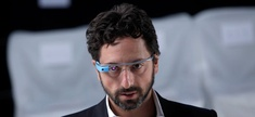 Google co-founder Sergey Brin dons a pair of Google Glasses