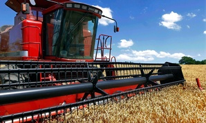 Illinois farmer Jacob Hermes uses a combine to harvest his winter wheat crop.