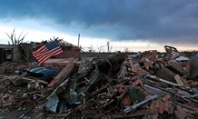 A flag blows in rubble in Oklahoma Tuesday.