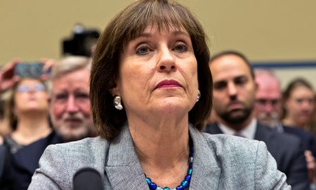 Lois Lerner, head of the IRS unit that decides whether to grant tax-exempt status to groups, listens during a hearing on Capitol Hill.