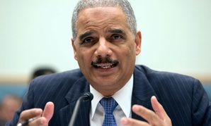 Attorney General Eric Holder gestures while testifying on Capitol Hill in Washington.