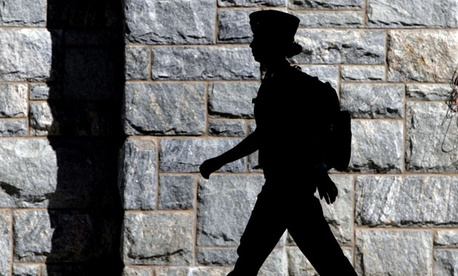 A female cadet walks on campus at the United States Military Academy at West Point, N.Y.