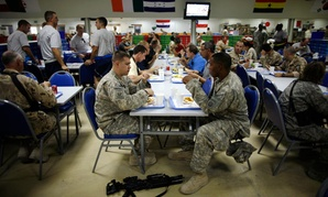 Service members eat lunch inside the chow hall at Kandahar Airfield, Afghanistan.