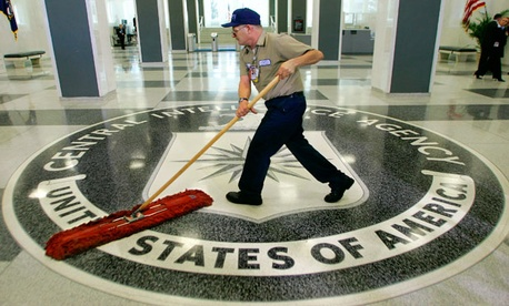 A custodian sweeps the lobby of the CIA.