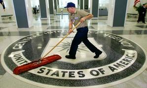 A custodian sweeps the lobby of the CIA.