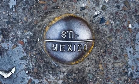 A sign marks the border near San Ysidro, California.