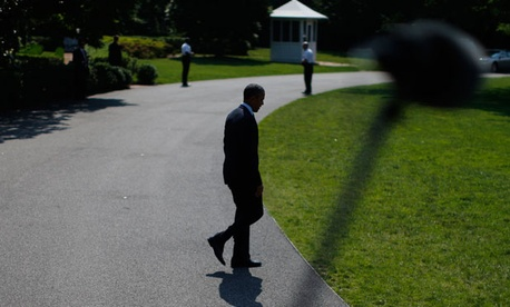 Barack Obama walks outside the White House in June.
