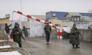Afghan contractors work in Kabul in December.