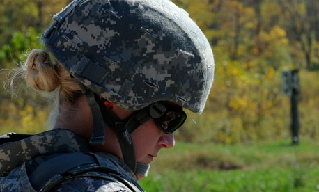 A female soldier goes through a training exercise in 2011.
