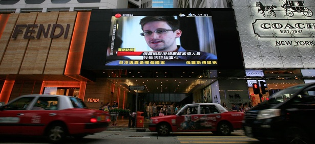 An outdoor screen in Hong Kong shows an Edward Snowden interview.