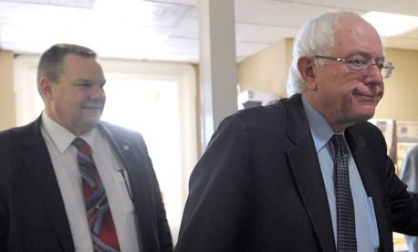"Sens. Bernie Sanders, I-Vt., right, and Jon Tester, D-Mont., called the notification from the department ""inappropriate for the task at hand given the enormity and sensitivity of this issue."""