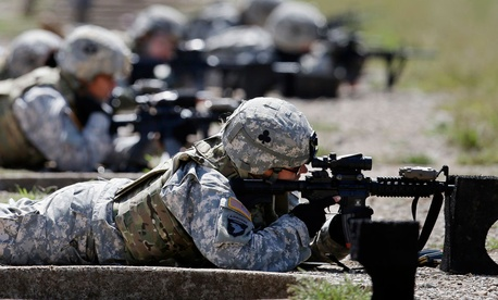 Female soldiers train on a firing range in 2012.