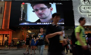 A screen in Hong Kong shows an interview with NSA leaker Edward Snowden.