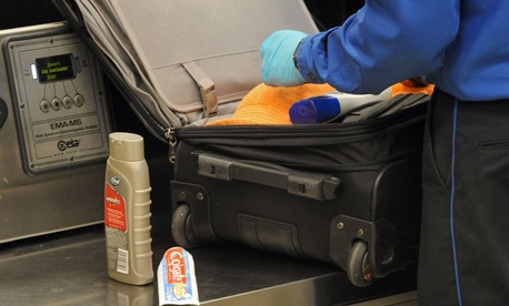 A TSA screener searched a bag in Atlanta in 2011.