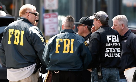 FBI agents gather near the finish line of the Boston Marathon in Boston Tuesday, April 16, 2013.