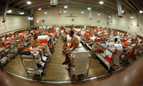 Inmates sit at the California Institute for Men in Chino