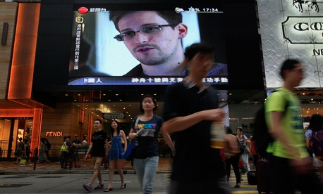 A Hong Kong mall TV screen shows a news report of Edward Snowden in June.