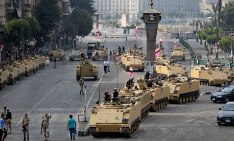 Armored vehicles gather in Cairo's Tahrir Square last week.