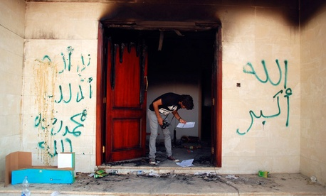 A man looks at documents at the U.S. consulate in Benghazi, Libya, after an attack that killed four Americans, Sept. 12, 2012.
