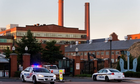 Police line the gate of the Navy Yard Tuesday.