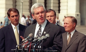 John Boehner looks over the shoulder of then-House Speaker Newt Gingrich at a 1998 press conference.