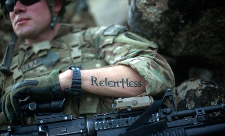 "A tattoo reading ""relentless"" decorates the arm of U.S. Army Pfc. Mitchell Clark in in Kunar province, Afghanistan."